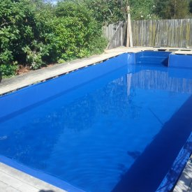 liner pool (after) with new in-built steps and new dark blue modern liner